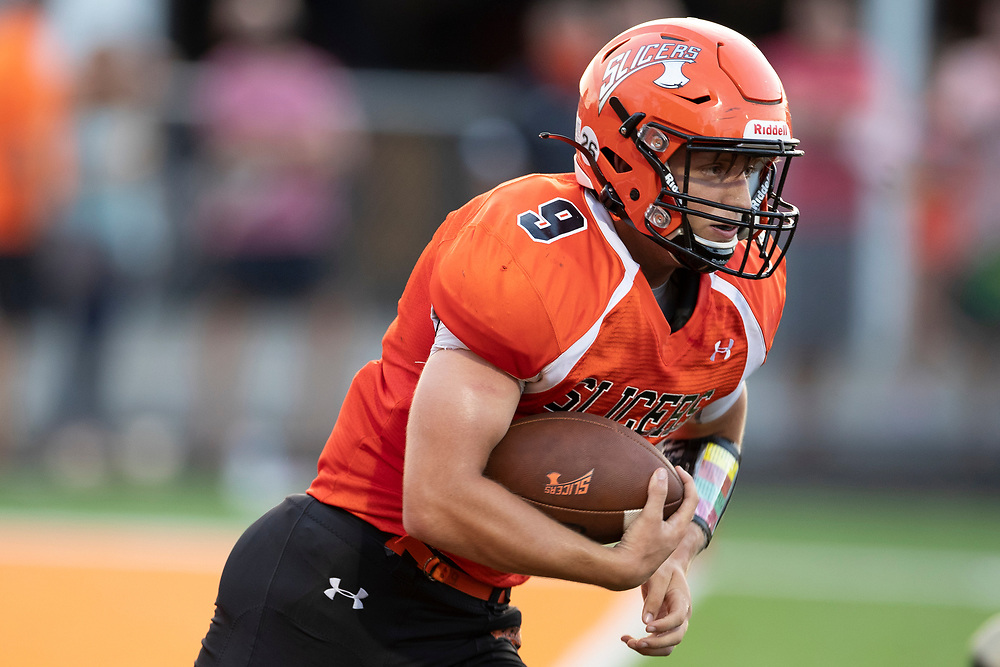 LaPorte's Collin Bergquist runs with the ball for yardage during the Penn-LaPorte high school football game on Friday, August 28, 2020, at Kiwanis Field in LaPorte, Indiana.