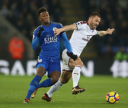 Leicester City's Demarai Gray and Burnley's Phil Bardsley battle for the ball