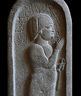 Neo Hittite basalt funerary stele from Neirab or Tell Afis, Syria, 7th cent BC. Louvre Museum. Black background