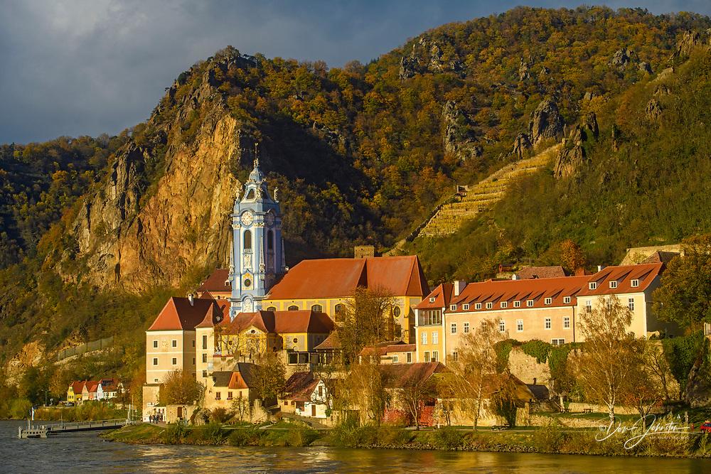 Autumn in the Wachau Valley- Durnstein parish church on the banks of the Danube, Durnstein, Lower Austria, Austria