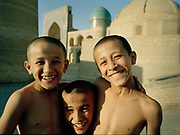 Kids at the Mir-i-Arab Medressa, most famous mosque in the the fabled city of Bukhara, on the ancient Silk Road. Uzbekistan.