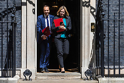 © Licensed to London News Pictures. 21/05/2019. London, UK. Secretary of State for Health and Social Care Matt Hancock (L) and Secretary of State for Work and Pensions Amber Rudd (R) leave 10 Downing Street after the Cabinet meeting. Prime Minister Theresa May is expected to make a statement to Paliament outlining changes to the Withdrawal Agreement Bill before it is brought back before Parliament. Photo credit: Rob Pinney/LNP