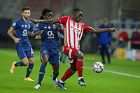 PIRAEUS, GREECE - DECEMBER 09: Mohamed Camara of Olympiacos FC and  Romário Baró of FC Porto during the UEFA Champions League Group C stage match between Olympiacos FC and FC Porto at Karaiskakis Stadium on December 9, 2020 in Piraeus, Greece. (Photo by MB Media)