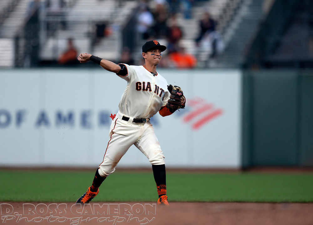 San Francisco Giants second baseman Mauricio Dubon throws out San Diego Padres' Ty France at first base during the second inning of a baseball game, Thursday, Aug. 29, 2019, in San Francisco. (AP Photo/D. Ross Cameron)
