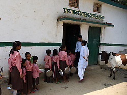 September 7, 2017 - Allahabad, Uttar Pradesh, India - Allahabad: Students in quue to take food under Mid Day meal scheme after attend class at a government primary school on the eve of International Literacy Day in Allahabad on 07-09-2017. September 8 was declared International Literacy Day by UNESCO on November 17, 1965. Its aim is to highlight the importance of literacy to individuals, communities and societies. Celebrations take place in several countries (Credit Image: © Prabhat Kumar Verma via ZUMA Wire)