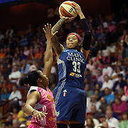 Seimone Augustus, (right), Minnesota Lynx, shoots over Alex Bentley, Connecticut Sun, during the Connecticut Sun Vs Minnesota Lynx, WNBA regular season game at Mohegan Sun Arena, Uncasville, Connecticut, USA. 27th July 2014. Photo Tim Clayton