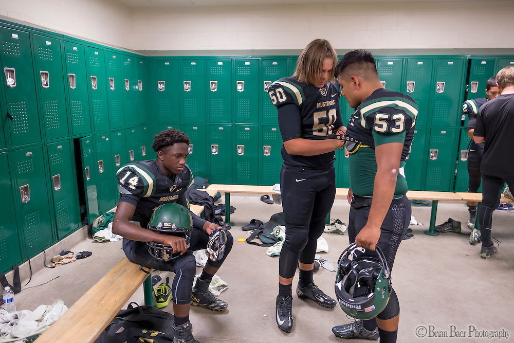 The Monterey Trail Mustangs gets ready inside the locker room before the game as the Monterey Trail Mustangs host the Sheldon High School Huskies Friday Sep 23, 2016.<br /> photo by Brian Baer