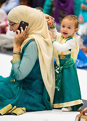 A mother and child during the Eid in Excel event, in association with the Al-Khair Foundation, at ExCeL London, which is London's largest Eid celebration.