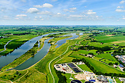 Nederland, Overijssel, Zwolle, 17-07-20170; de IJssel ter hoogte van Westenholte. In het kader van het programma Ruimte voor de rivier is de dijk landinwaarts verlegd en zijn er hoogwatergeulen gegraven. Door de dijkverlegging worden de uiterwaarden breder en krijgt de rivier meer ruimte.<br /> River IJssel north of Zwolle. The river dike has been shifted (landward) with newly excavated channels. Moving the dike has broadened the floodplains, creating more space for the river.<br /> <br /> luchtfoto (toeslag op standard tarieven);<br /> aerial photo (additional fee required);<br /> copyright foto/photo Siebe Swart
