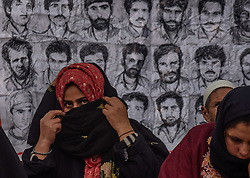 December 10, 2016 - Srinagar, Jammu and Kashmir, India - Relatives of the disappeared persons and the members of the Association of Parents of the Disappeared (APDP) take part in a protest on the international Human Rights Day on December 10, 2016 in Srinagar, the summer capital of Indian administered Kashmir, India.  Indian government forces in Kashmir are often blamed for grave rights abuses like widespread torture, rape, custodial murder and enforced disappearances in the Muslim-majority region Since 1989, Kashmir has been a state under siege, with both India and Pakistan laying claim to it. Human rights organizations say more than 80,000 have died in the two decade long conflict with the Indian government claiming the number as 40,000. (Credit Image: © Yawar Nazir via ZUMA Wire)