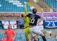 Football - 2019 / 2020 EFL Championship -  Millwall vs. Huddersfield Town<br /> <br /> Matt Smith (Millwall FC) challenges Joel Coleman (Huddersfield Town) for the cross at The Den.<br /> <br /> COLORSPORT/DANIEL BEARHAM