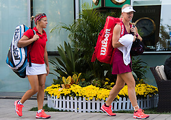 October 2, 2018 - Kiki Bertens of the Netherlands & Kirsten Flipkens of Belgium on their way to the court for their match at the 2018 China Open WTA Premier Mandatory tennis tournament (Credit Image: © AFP7 via ZUMA Wire)