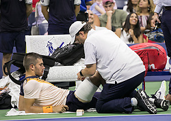 September 2, 2018 - Flushing Meadows, New York, U.S - Borna Coric  receives medical attention during his match against Juan Martin del Potro on Day 7 of the 2018 US Open at USTA Billie Jean King National Tennis Center on Sunday September 2, 2018 in the Flushing neighborhood of the Queens borough of New York City. Del Potro defeats Coric, 6-4, 6-3, 6-1. (Credit Image: © Prensa Internacional via ZUMA Wire)