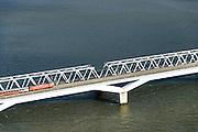 Nederland, Zuid-Holland, Gemeente Strijen, 23-10-2013; HSL-brug over het Hollandsch Diep, Moerdijkbrug. De trein is een intercity direct (voorheen Fyra), onderweg naar Breda. <br /> HSL bridge over the Moerdijk The train is a 'intercity direct' (formerly Fyra), en route to Breda.<br /> luchtfoto (toeslag op standard tarieven);<br /> aerial photo (additional fee required);<br /> copyright foto/photo Siebe Swart