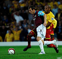 Photo: Richard Lane.<br />Watford v West Ham United. The Barclays Premiership. 22/08/2006. West Ham's Lee Bowyer is challenged by Watford's Marlon King.