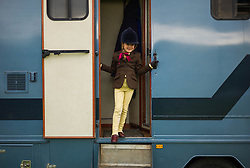 © Licensed to London News Pictures.29/08/15<br /> Bilsdale, UK. <br /> <br /> A young rider stands in the doorway of their horsebox during the 105th Bilsdale Country Show in North Yorkshire.<br /> <br /> Photo credit : Ian Forsyth/LNP
