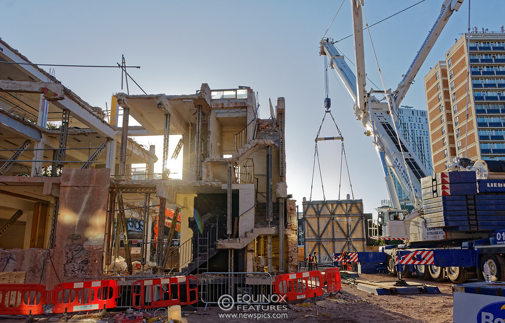 London, United Kingdom - 20 September 2019<br /> EXCLUSIVE SET - Aerial construction specialists and demolition experts use a huge crane to carefully lift intact, a twenty five ton, two-story wall, to preserve a famous Banksy rat image which has been covered up for years. Teams from specialist companies have spent over six weeks cutting around the artwork and fitting custom made eight ton steel supports to enable them to save the historic piece of art. Work has started on the construction of a new twenty seven floor art'otel hotel on the site of the old Foundry building in Shoreditch, east London, and a condition of the planning permission was to preserve the historical Banksy graffiti. A second section of the painting, an image of a TV being thrown through a broken window has already been cut out and moved separately. After the hotel construction is complete the two parts of the Banksy painting will be displayed on the hotel. Our pictures show the stages of work to protect the image, culminating in the lifting of the three story wall by crane. Video footage also available.<br /> (photo by: EQUINOXFEATURES.COM)<br /> Picture Data:<br /> Photographer: Equinox Features<br /> Copyright: ©2019 Equinox Licensing Ltd. +443700 780000<br /> Contact: Equinox Features<br /> Date Taken: 20190920<br /> Time Taken: 17360400<br /> www.newspics.com
