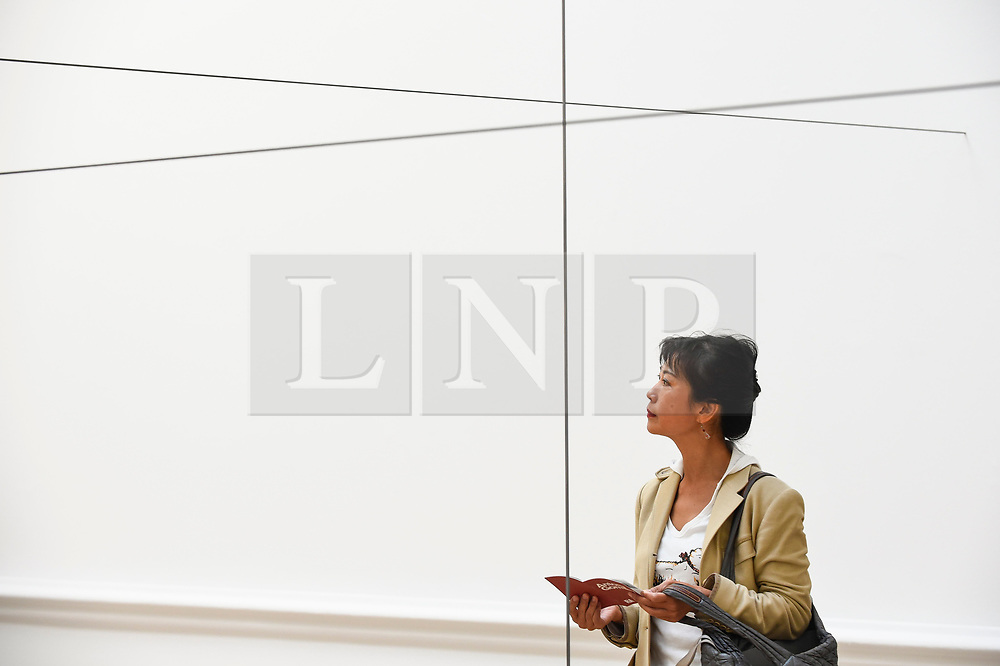 """© Licensed to London News Pictures. 17/09/2019. LONDON, UK. A visitor views """"Co-ordinate VI"""", 2019, by Antony Gormley. Preview of a new exhibition by Antony Gormley at the Royal Academy of Arts.  The show bring together existing and specially conceived new works from drawing to sculptures to experimental environments to be displayed in all 13 rooms of the RA's Main Galleries 21 September to 3 December 2019.  Photo credit: Stephen Chung/LNP"""