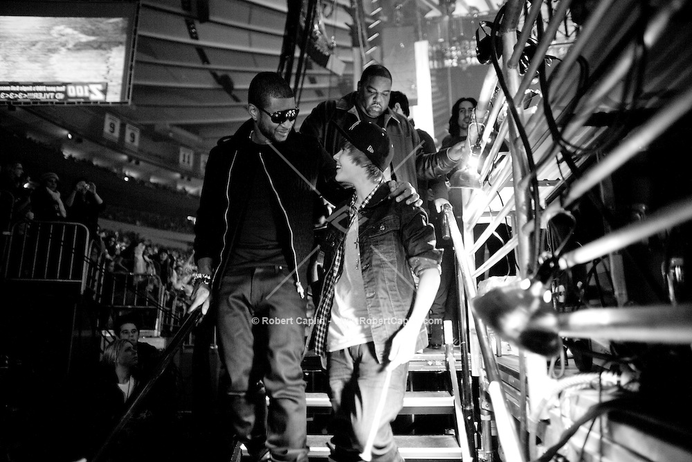 Usher and Justin Bieber walk off the stage at the 2009 Z100's Jingle Ball at Madison Square Garden in New York. It was Bieber's first performance at The Garden. ..(Photo by Robert Caplin)..