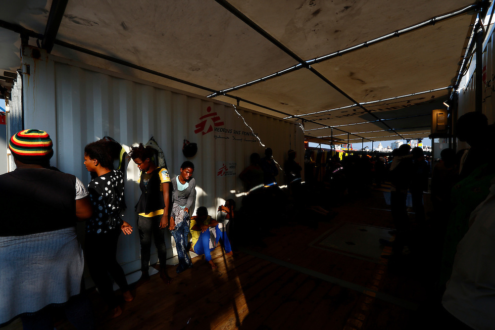 Migrants line up on the deck of the Medecins san Frontiere (MSF) rescue ship Bourbon Argos as it arrives in Trapani, on the island of Sicily, Italy, August 9, 2015.  Some 241 mostly West African migrants on the ship arrived on the Italian island of Sicily on Sunday morning, according to MSF.<br /> REUTERS/Darrin Zammit Lupi <br /> MALTA OUT. NO COMMERCIAL OR EDITORIAL SALES IN MALTA