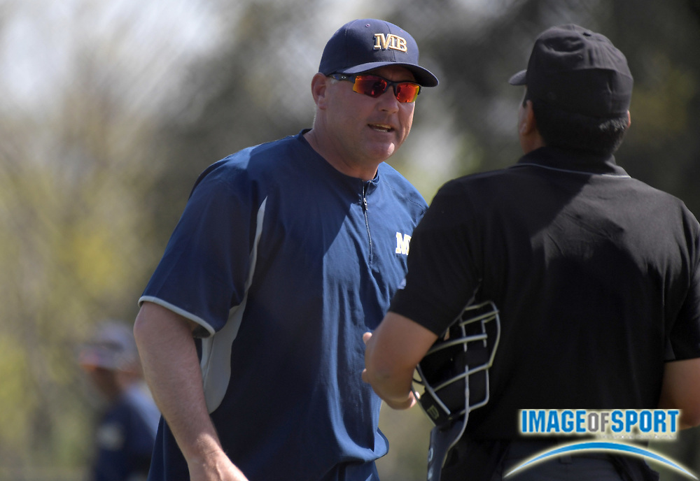 Cal State Monterey Bay Otters coach Walt White argues with an umpire during an NCAA College baseball game against the Cal  Poly Pomona Broncos in Pomona, Calif., Friday, April 13, 2018.