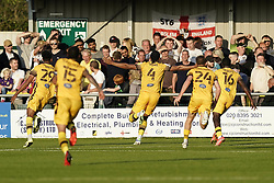 Sutton United's Coby Rowe (third left) celebrates scoring the winning goal during the Sky Bet League Two match at Borough Sports Ground, Sutton. Picture date: Saturday October 9, 2021.