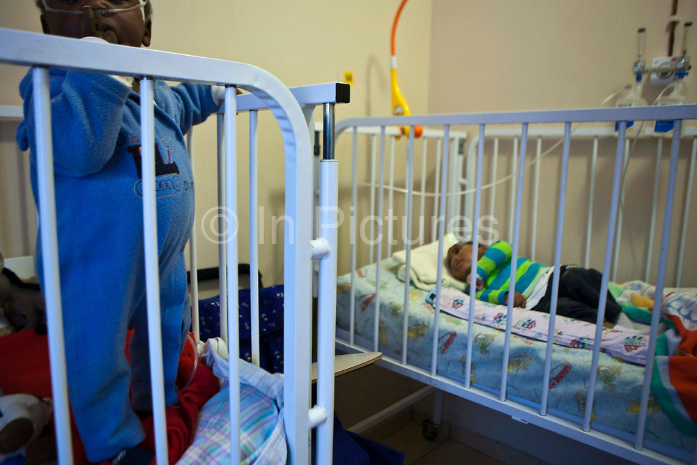 African babies in their cots at Lambano Sanctuary, a hospice for orphaned children with HIV in Guateng, South Africa.