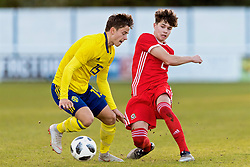 BANGOR, WALES - Saturday, November 17, 2018: Wales' Neco Williams (R) and Sweden's Benjamin Tannus during the UEFA Under-19 Championship 2019 Qualifying Group 4 match between Sweden and Wales at the Nantporth Stadium. (Pic by Paul Greenwood/Propaganda)