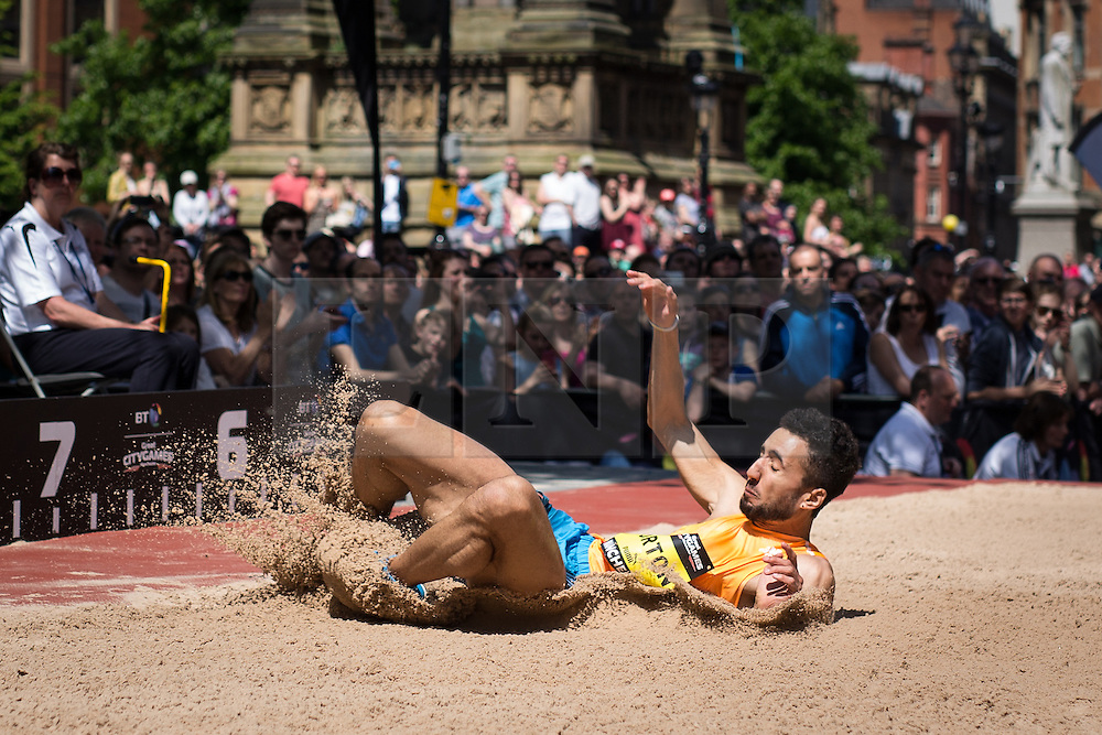 © Licensed to London News Pictures . 17/05/2014 . Manchester , UK . MATTHEW BURTON . The Great City Games in Manchester , with athletics on a track along Deansgate and Pole Vault and Long Jump in Albert Square . Photo credit : Joel Goodman/LNP
