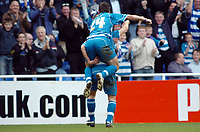 Photo: Kevin Poolman.<br />Reading v Stoke City. Coca Cola Championship. 17/04/2006. Reading's Shane Long jumps on the back of Steve Sidwell to celebrate his goal and Reading first.