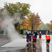PARIS, FRANCE September 28.   Ball boys and ball girls warming up outside Court Philippe-Chatrier on a wet autumn day as steam rises from a vent as they prepare for day two of of the French Open Tennis Tournament at Roland Garros on September 28th 2020 in Paris, France. (Photo by Tim Clayton/Corbis via Getty Images