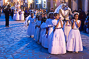 09 APRIL 2004 - SAN MIGUEL DE ALLENDE, GUANAJUATO, MEXICO: Dressed in white, girls from Iglesia Oratorio participate in the church Good Friday procession in San Miguel de Allende, GTO, MEX. The Good Friday procession from Oratorio is one of the most ornate in Mexico. The dignitaries, whose role in the procession is handed down from father to son and mother to daughter, accompany the procession carrying tall lantern and statues representing aspects of the life of Christ. Semana Santa, the week before Easter, is celebrated with extreme piety in central Mexico. San Miguel, which was founded in the 1600s, is one of Mexico's premier colonial cities. It has very strict zoning and building codes meant to preserve the historic nature of the city center. About 7,500 US citizens, mostly retirees, live in San Miguel. PHOTO BY JACK KURTZ