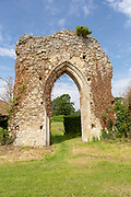 Ruined stone arch of abbey church, Butley priory, Suffolk, England, UK