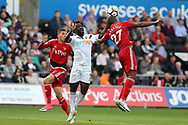Wilfried Bony of Swansea city is challenged by  Christian Kabasele of Watford ® in the penalty box and the ball appears to hit the arm of Kabasele (27) but play is waved on. .  Premier league match, Swansea city v Watford at the Liberty Stadium in Swansea, South Wales on Saturday 23rd September 2017.<br /> pic by  Andrew Orchard, Andrew Orchard sports photography.