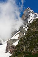 Russia, Caucasus, Teberdinsky biosphere reserve. Mountain and fog in Alibek Valley near Dombay.