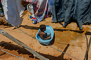 Enzo Gabriel, two years old, enjoys a baby bathtube on a sunny day in Rosa Leão Occupancy, Isidoro area.