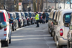 Whitehall, London, February 10th 2016. Taxis queue up on Whitehall as an estimated 8,000 cabbies hold a go-slow in protest against what they say is unfair competition from minicab and Uber drivers who do not have to undergo the rigorous training and checks required for the licenced taxi trade. ///FOR LICENCING CONTACT: paul@pauldaveycreative.co.uk TEL:+44 (0) 7966 016 296 or +44 (0) 20 8969 6875. ©2015 Paul R Davey. All rights reserved.