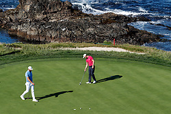 June 11, 2019 - Pebble Beach, CA, U.S. - PEBBLE BEACH, CA - JUNE 11: PGA golfers Dustin Johnson and Martin Kaymer putt on the 7th hole during a practice round for the 2019 US Open on June 11, 2019, at Pebble Beach Golf Links in Pebble Beach, CA. (Photo by Brian Spurlock/Icon Sportswire) (Credit Image: © Brian Spurlock/Icon SMI via ZUMA Press)