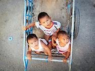 Sea Gypsy children in Koh Siray (Sirey) Phuket Thailand
