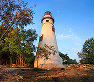 The Marblehead Lighthouse Bathed In In Early Morning Light On Lake Erie At Marblehead Ohio, USA