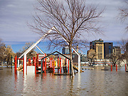 29 MARCH 2019 - ST. PAUL, MN: A flooded playground on the bank of the Mississippi River in St. Paul. The Mississippi River through the Twin Cities has already hit flood stage. Several roads and parks in St Paul are already closed in anticipation of higher flood levels. Weather forecasters and hydrologists have backed off a little on earlier predictions of severe flooding because the snow melt has been slower than expected.      PHOTO BY JACK KURTZ
