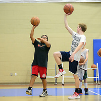 060214  Adron Gardner/Independent<br /> <br /> Kairi Ashley, left, follows the form of Lance McMullin at the Rehoboth basketball camp in Rehoboth Monday.
