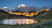 Cordillera Huayhuash reflects in Carhuacocha lake (13,600 feet) in the Andes Mountains, Peru, South America. Peaks from left to right are: Siula Grande, Yerupaja Grande (6635 m or 21,770 ft, highest point in the Amazon watershed), Yerupaja Chico, and Mount Jirishanca (Icy Beak of the Hummingbird). Day 3 of 9 days trekking around the Cordillera Huayhuash. This panorama was stitched from 2 overlapping photos.