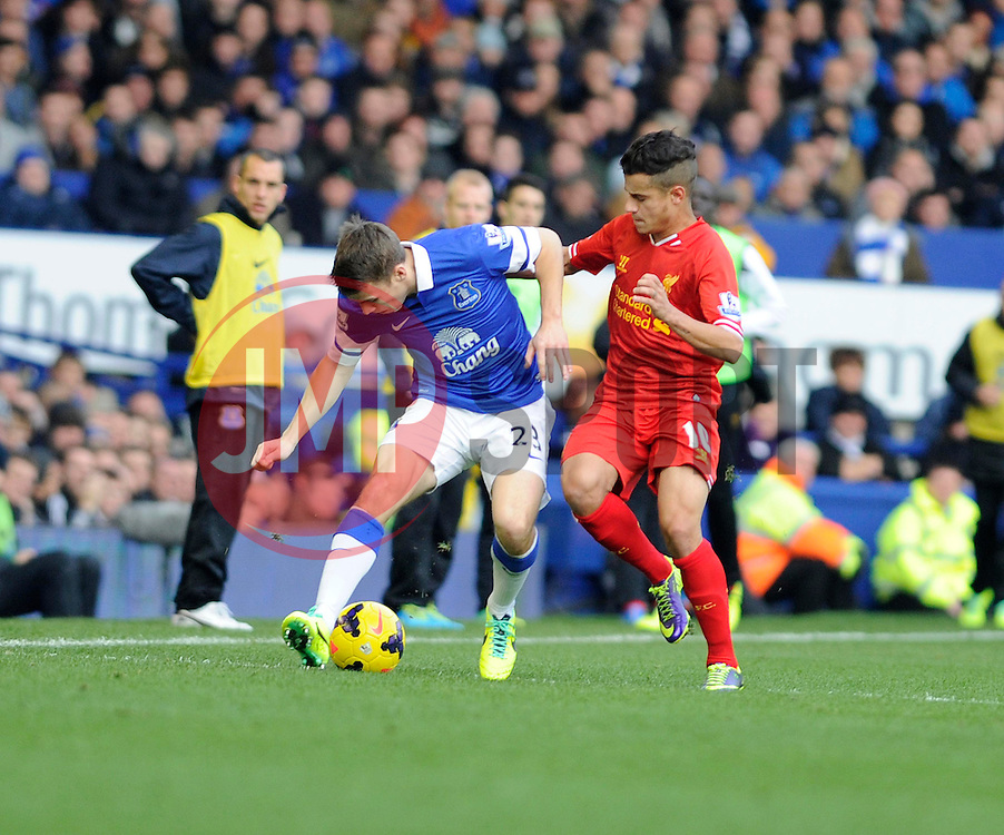 Everton's Seamus Coleman controls the ball under pressure from Liverpool's Philippe Coutinho - Photo mandatory by-line: Dougie Allward/JMP - Tel: Mobile: 07966 386802 23/11/2013 - SPORT - Football - Liverpool - Merseyside derby - Goodison Park - Everton v Liverpool - Barclays Premier League