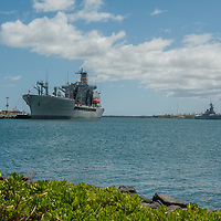 A warship is tied up at a dock in Pearl Harbor in Honolulu, Oahu, Hawaii.