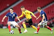 Thorgan Hazard (#16) of Belgium takes on John McGinn (#7) of Scotland during the International Friendly match between Scotland and Belgium at Hampden Park, Glasgow, United Kingdom on 7 September 2018.