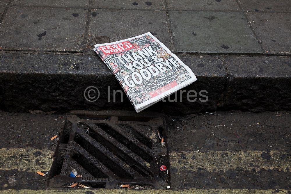 "The last ever copy of tabliod newspaper News of The World in the gutter, where many people believe it belonged. Sunday 10th July 2011 saw the end for this most famous of newspapers. Embroiled in the phone hacking scandal, this News International paper had approximately 7 million readers at the time of it's demise. On the cover of this, the final edition, with examples of previous journalistic success the headline simply read ""Thank You & Goodbye""."