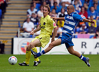 Photo: Daniel Hambury.<br /> Reading v Millwall. Coca Cola Championship.<br /> 20/08/2005.<br /> Reading's Glen Little tries in vain to tackle  Millwall's David Livermore.