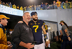 Sep 8, 2018; Morgantown, WV, USA; West Virginia Mountaineers quarterback Will Grier (7) celebrates with fans after beating the Youngstown State Penguins at Mountaineer Field at Milan Puskar Stadium. Mandatory Credit: Ben Queen-USA TODAY Sports