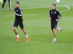 Real Madrid's Cristiano Ronaldo and Real Madrid's Gareth Bale - Photo mandatory by-line: Joe Meredith/JMP - Mobile: 07966 386802 11/08/2014 - SPORT - FOOTBALL - Cardiff - Cardiff City Stadium - Real Madrid v Sevilla - UEFA Super Cup - Press Conference and Open Training session